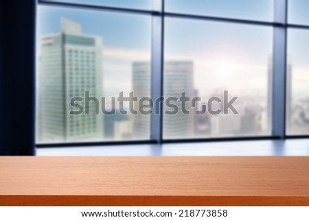 desk of red and city  - stock photo