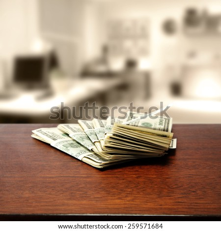 desk of wood and dollars in office