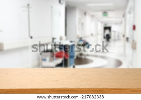 desk of wood in hospital and free space  - stock photo