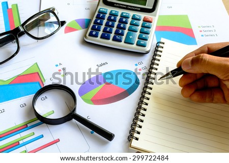 Desk office business financial accounting calculate, Graph analysis - stock photo