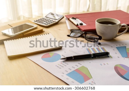 Desk office business financial accounting calculate with soft light, Graph analysis, Business concept - stock photo