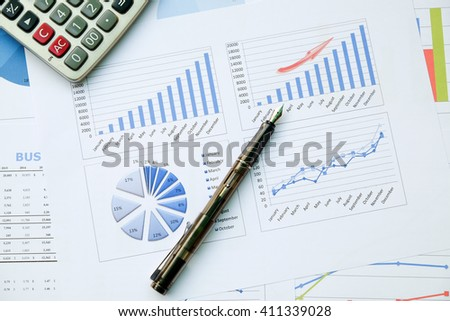 Desk office with pen, analysis report ,calculator. view from top. concept of business analysis, data analysis.