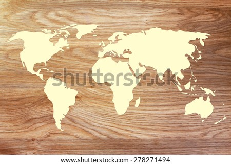 desk or wooden texture with world map silhouette - stock photo