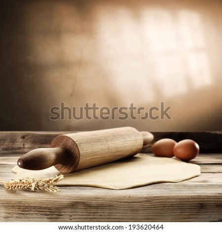 desk rolling pin and eggs  - stock photo