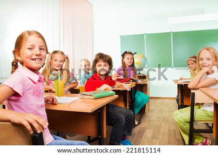 Desk rows with boys and girls sitting in classroom