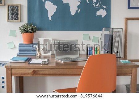 Desk with a laptop for children in the house  - stock photo