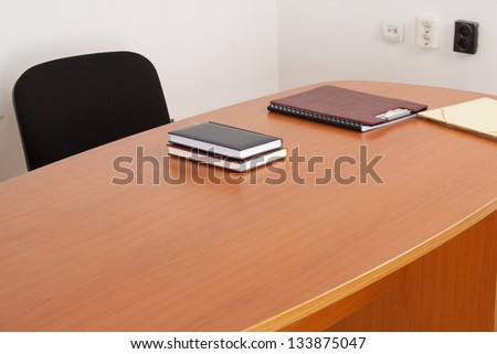 Desk with documents and books. Meeting room interiror.