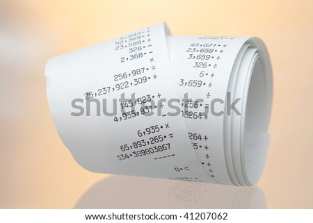 desktop calculator paper roll, closeup - stock photo
