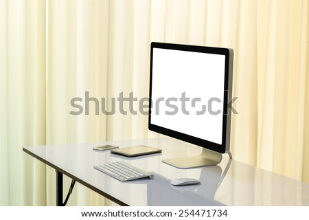Desktop computer with blank white screen for advertising - stock photo