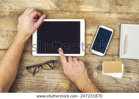 Desktop mix on a wooden office table background. View from above. - stock photo