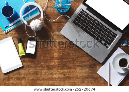 Desktop mock up with laptop, digital tablet, smartphone and stationery - stock photo