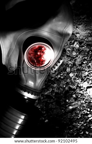 Desolate And Dark Photo Of A WW2 German Gasmask Blood Stained In The Inside After A Solider Sustained A Fatal Bullet Wound To The Head - stock photo