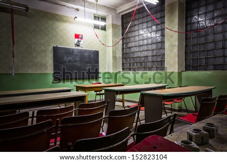 desolate classroom in an industrial firm - stock photo