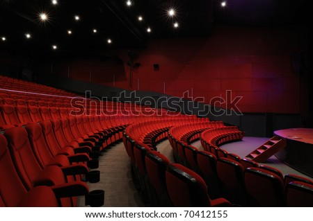 Desolate red cinema hall - stock photo