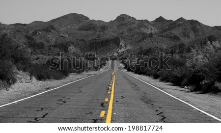 Desolate road in the desert, Arizona USA - stock photo