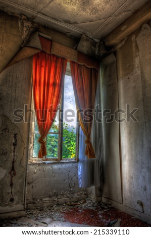 Desolate window in an abandoned house - stock photo