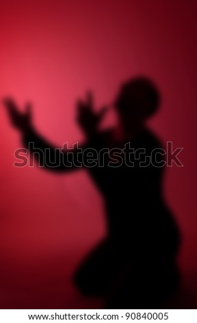 despair as dream concept. abstract image of man praying or pleading. male on his knees begging - stock photo