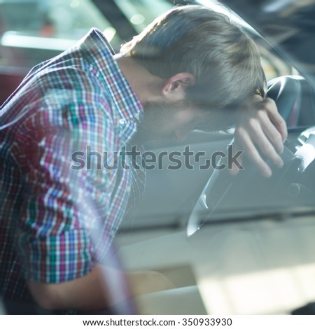 Despair driver having problem with his car - stock photo