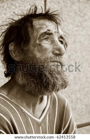 Despair of homeless tramp. - stock photo