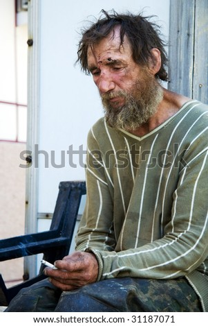 Despair of the poor homeless. - stock photo