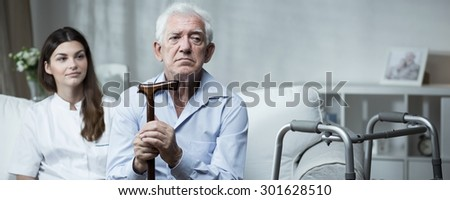 Despair senior man living in rest home - stock photo