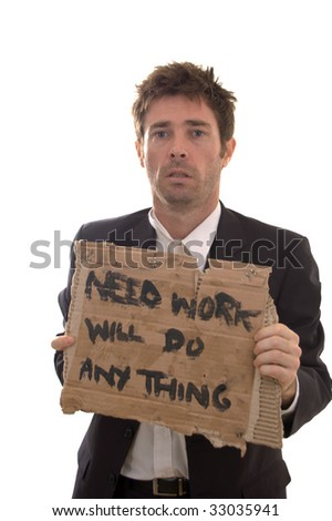 despair showing on face of retrenched business man - stock photo