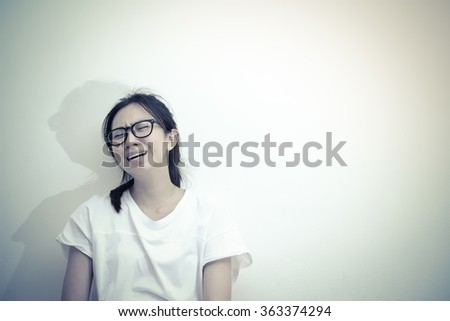 Desperate asian woman crying - stock photo