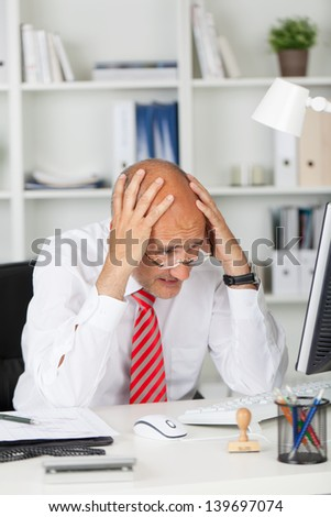 desperate businessman having problems with computer - stock photo