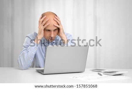 desperate businessman with laptop