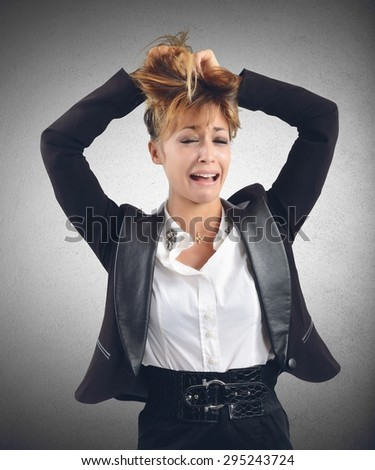Desperate businesswoman cries for her work failures - stock photo