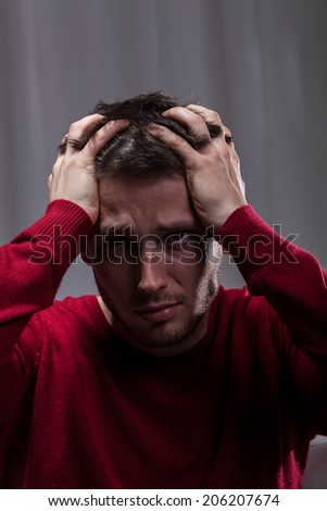 Desperate crazy man can't handle his problems  - stock photo