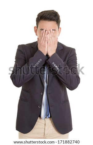 desperate hispanic man with hand in face - stock photo