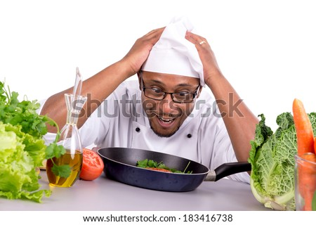 Desperate male chef with fruits and vegetables cooking - stock photo