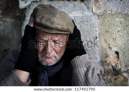 Desperate man on the street - stock photo