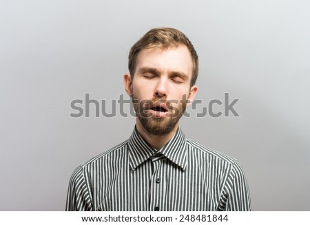 desperate man puts his hands in the hair - stock photo