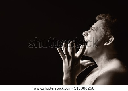 Desperate man, shouting and raging. OTHER PHOTOS FROM THIS SERIES IN MY PORTFOLIO. - stock photo
