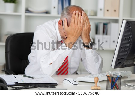 desperate manager holding hands on his head - stock photo