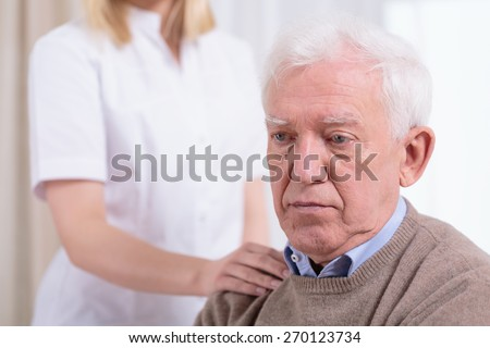 Desperate sad pensioner living in residential home - stock photo