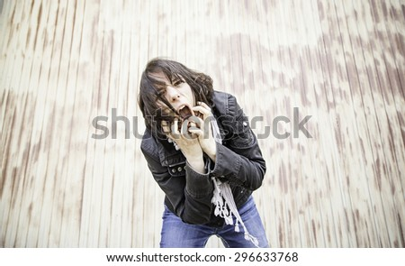 Desperate woman shouting violent, emotion and feeling - stock photo