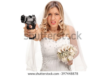 Desperate young bride pointing a gun towards the camera isolated on white background - stock photo