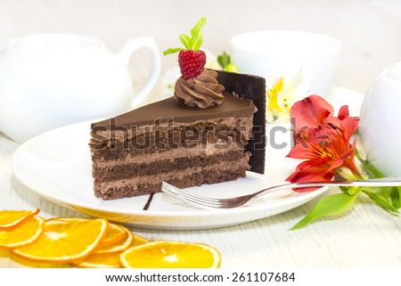 dessert, a piece of cake on the table with a cup of tea - stock photo