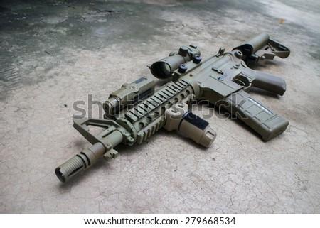Dessert assault rifles on the ground - stock photo