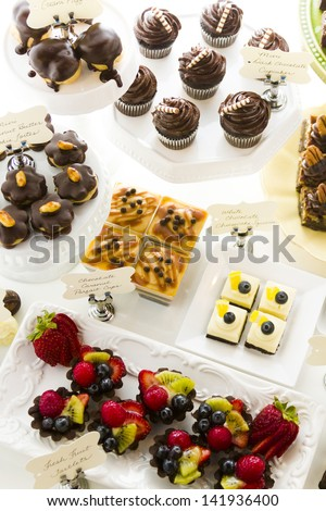 Dessert bar with assorted chocolate sweets. - stock photo