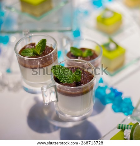 Dessert canape selection on slate platter - Chocolate mousse - stock photo