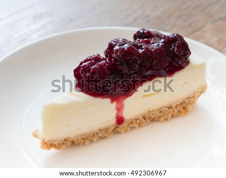 Dessert - Cheesecake with Berries Sauce on white plate