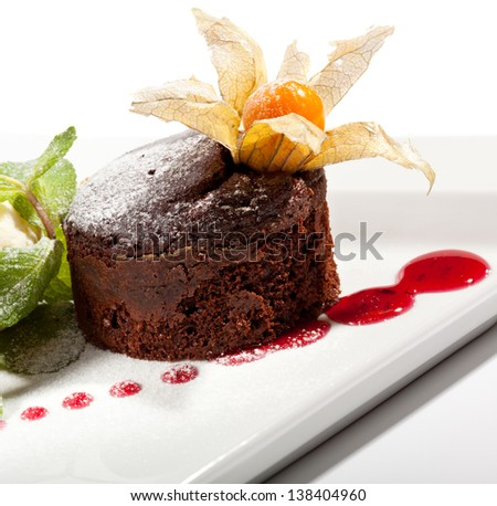 Dessert - Chocolate Cake with Berries Sauce and Ice Cream - stock photo