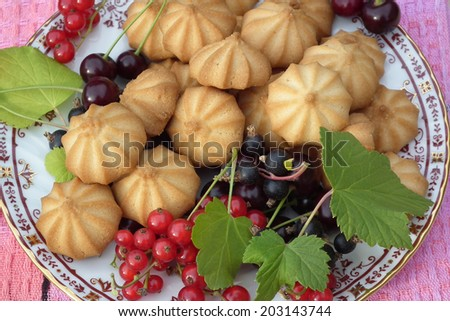 Dessert. Cookies and berries. - stock photo