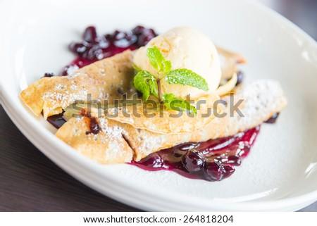 Dessert crepe and ice cream - stock photo