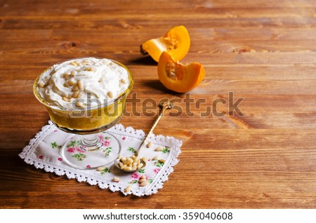 Dessert from the pumpkin and seeds with whipped cream. Selective focus. - stock photo