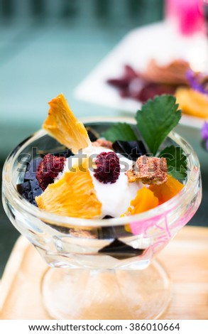 Dessert ice cream coconut with dried fruits - stock photo